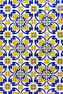 Vintage yellow and blue tiles, Algarve, Portugal