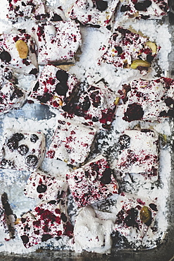 Christmas baking, close up of slices of a traybake with berries and nuts
