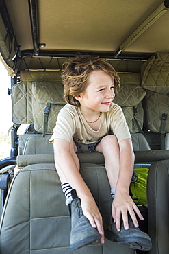 A smiling Six year old boy in safari vehicle