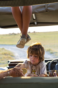 5 year old boy in safari vehicle, Kalahari Desert, Makgadikgadi Salt Pans, Botswana