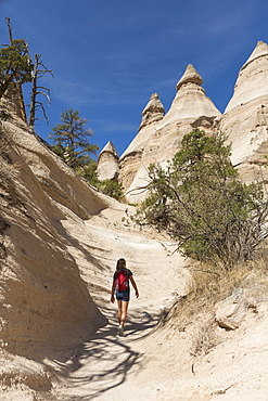 12 year old girl hiking in beautiful slot canyon Kasha Katuwe Tent Rocks, New Mexico