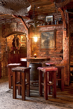 A hotel with old fashioned retro styled rooms, and rustic objects, bar table and stools, Estonia
