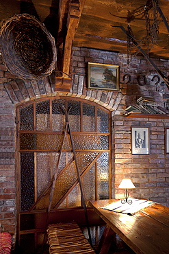 A hotel with old fashioned retro styled rooms, and rustic objects, staine glass, exposed brick and old photographs, Estonia