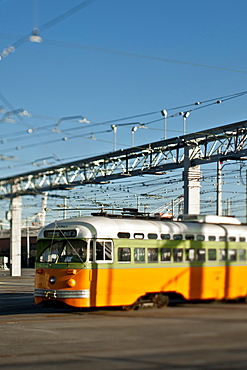 Tram with power lines above