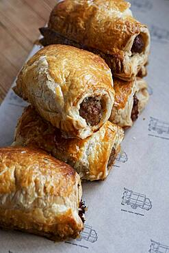 High angle close up of freshly baked sausage rolls.