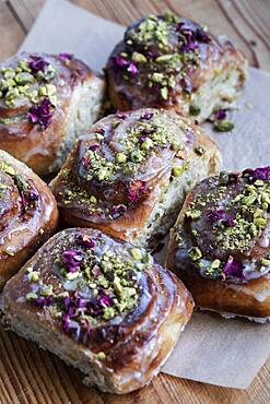 High angle close up of freshly baked Danish Pastries with Pistachio Nuts.