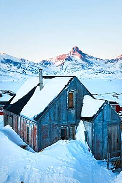 House in winter covered in snow, Tasiilaq, south eastern Greenland