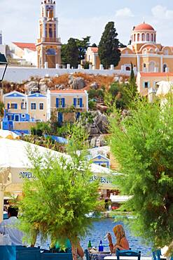 Symi Town, elevated view, rooftops, terraces, restaurant, people in the background