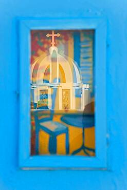 Reflection of church in picture window, Santorini, Cyclades Islands, Greece