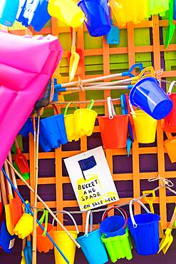 Bucket and spades and other beach items for sale, holiday resort, England