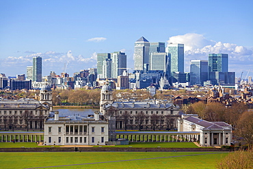 View of the The Old Royal Naval College and Canary Wharf, taken from Greenwich Park, London, England, United Kingdom, Europe