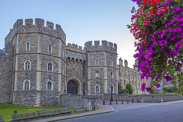 Windsor Castle in the morning with flowers in hanging baskets, Windsor, Berkshire, England, United Kingdom, Europe