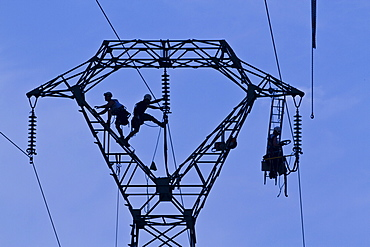 Workers on pylon, Brittany, France, Europe