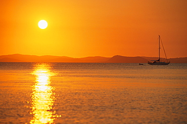 View to mainland from Monkey Beach at sunset, Great Keppel Island, Queensland, Australia