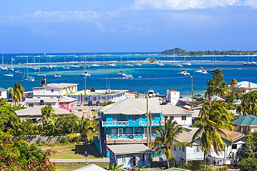 View of Clifton and Clifton harbour, Union Island, with Palm Island in the distance, The Grenadines, St. Vincent and The Grenadines, West Indies, Caribbean, Central America