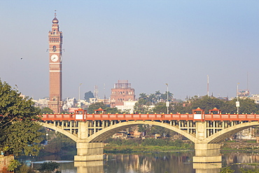Bridge over Gomti River with Clock Tower in distance, Lucknow, Uttar Pradesh, India, Asia