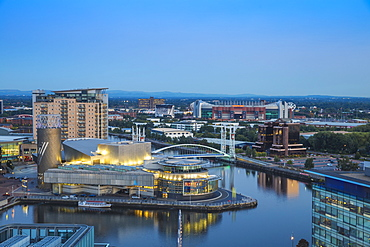 View of Salford Quays looking towards the Lowry Theatre and Old Trafford, Manchester, England, United Kingdom, Europe