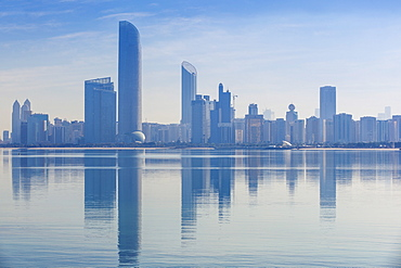 View of City skyline reflecting in Persian Gulf, Abu Dhabi, United Arab Emirates, Middle East