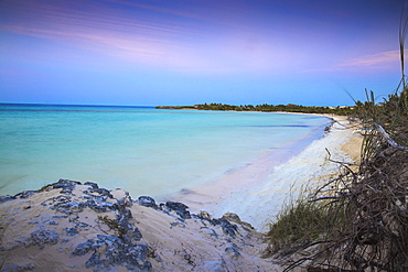 View of Playa Larga at sunset, Cayo Coco, Jardines del Rey, Ciego de Avila Province, Cuba, West Indies, Caribbean, Central America