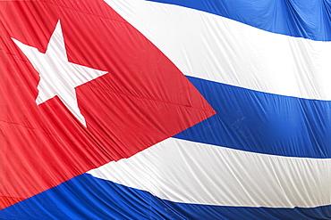 Cuban flag hanging across buildings in a street in Santa Clara, after the death of Fidel Castro, Santa Clara Cuba, West Indies, Caribbean, Central America