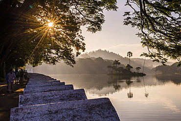Sunrise at Kandy Lake and the island which houses the Royal Summer House, Kandy, UNESCO World Heritage Site, Central Province, Sri Lanka, Asia