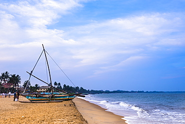 Traditional outrigger fishing boat (oruva), Negombo Beach, Negombo, Sri Lanka, Asia