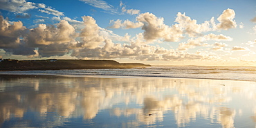 Cloud reflections at Constantine Bay at sunset, Cornwall, England, United Kingdom, Europe