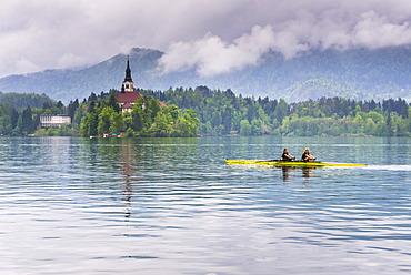 Canoeists on Lake Bled, Julian Alps, Gorenjska, Slovenia, Europe