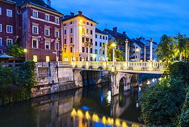 Bridge over the Ljubljanica River at night, Ljubljana, Slovenia, Europe