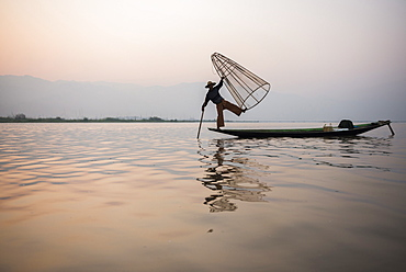Inle Lake fisherman at sunrise (Intha fisherman), near Nyaungshwe, Shan State, Myanmar (Burma), Asia