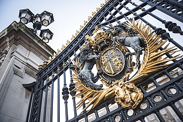 Royal Coat of Arms on the gates at Buckingham Palace, London, England, United Kingdom, Europe