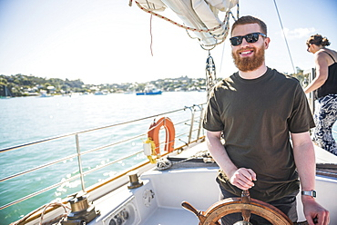 Tourist on a sailing boat trip in the Bay of Islands, from Russell, Northland Region, North Island, New Zealand, Pacific