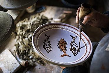 Woman decorating Horezu ceramics, a unique type of Romanian pottery, UNESCO Cultural Heritage List, Wallachia, Romania, Europe