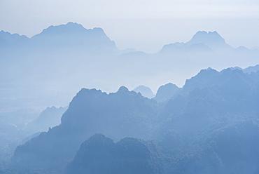 Misty limestone karst mountain landscape at sunrise, seen from Mount Zwegabin, Hpa An, Kayin State (Karen State), Myanmar (Burma), Asia
