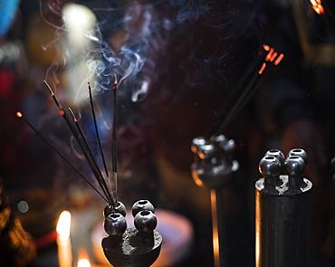 Incense burning at a Hindu temple in New Delhi, India, Asia