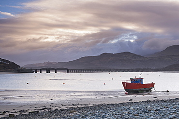 Fishing boat and Barmouth Bridge in Barmouth Harbour with Cader (Cadair) Mountains behind, Snowdonia National Park, North Wales, Wales, United Kingdom, Europe