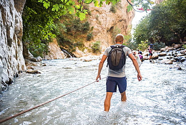 Tourist hiking in Saklikent Gorge, Saklikent National Park, Fethiye Province, Lycia, Anatolia, Turkey, Asia Minor, Eurasia