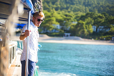 Tourist on Gulet sailing boat cruise, Kemer, Antalya Province, Lycia, Anatolia, Mediterranean Sea, Turkey, Asia Minor, Eurasia