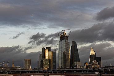Aeroplane flying over The City of London, London, England, United Kingdom, Europe