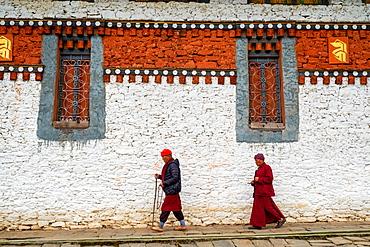 Bhutanese Pilgrims circumnavigate Tamzhing Monastery, Bumthang District, Bhutan, Asia