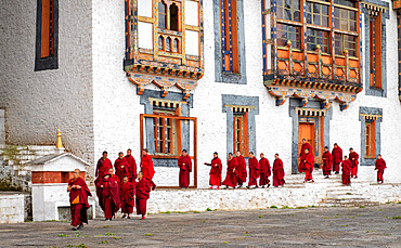 Buddhist monks, prayer time, Kurjey Lhakhang Monastery, Bumthang.
