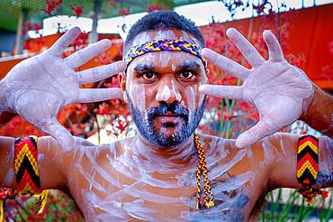 Portrait, Noongar Aboriginal dancers perform songs showcasing their culture in Yagan Square, Perth City, Western Australia, Australia, Pacific