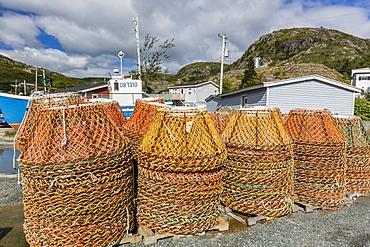Lobster traps near fishing boat outside St. John's, Newfoundland, Canada, North America