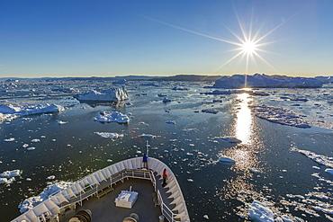 Expeditions ship amongst huge icebergs, Ilulissat, Greenland, Polar Regions