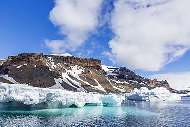 Rust-colored volcanic tuff cliffs of Brown Bluff, eastern side of the Tabarin Peninsula, Weddell Sea, Antarctica, Polar Regions