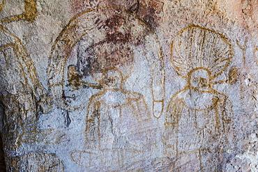 Aboriginal Wandjina cave artwork in sandstone caves at Bigge Island, Kimberley, Western Australia, Australia, Pacific