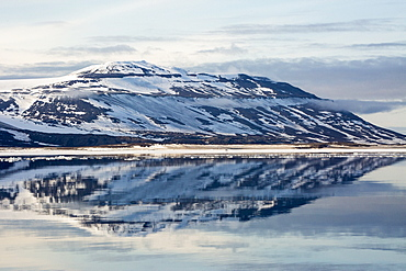 Snow-capped mountains reflected in the calm waters of Olga Strait, Svalbard, Arctic, Norway, Scandinavia, Europe