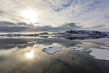 Sun and sky reflected in the calm waters of Olga Strait, Svalbard, Arctic, Norway, Scandinavia, Europe