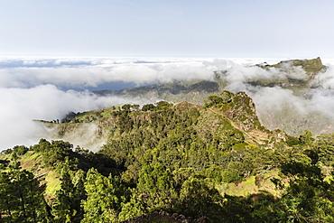Fog shrouds the volcanic mountains surrounding Cova de Paul on Santo Antao Island, Cape Verde, Africa