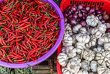 Red chillies, onions, and garlic for sale at fresh food market in Chau Doc, Mekong River Delta, Vietnam, Indochina, Southeast Asia, Asia